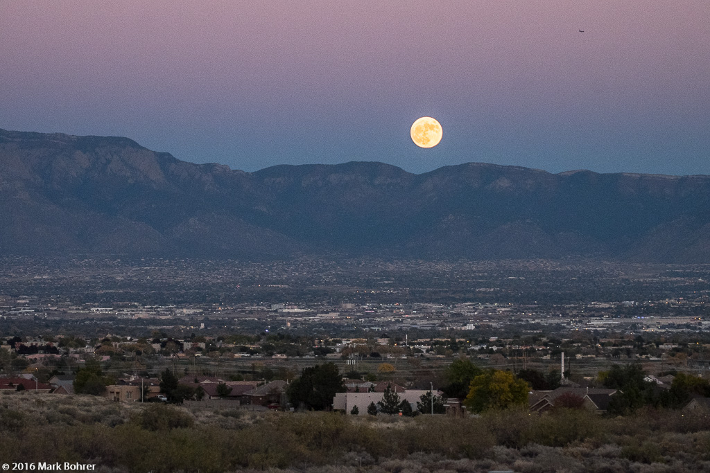 Rising supermoon and Sandia Mountains