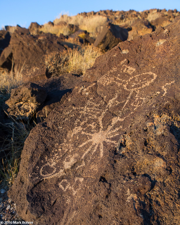 Mesa Prieta sunburst dancer petroglyph, Petroglyph National Monument