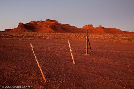 Sculpted sandstone in sunset blood red, Comb Ridge, Utah