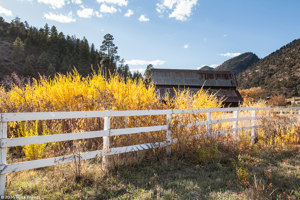 Barn and low-hanging color near Chimney Rock, Colorado