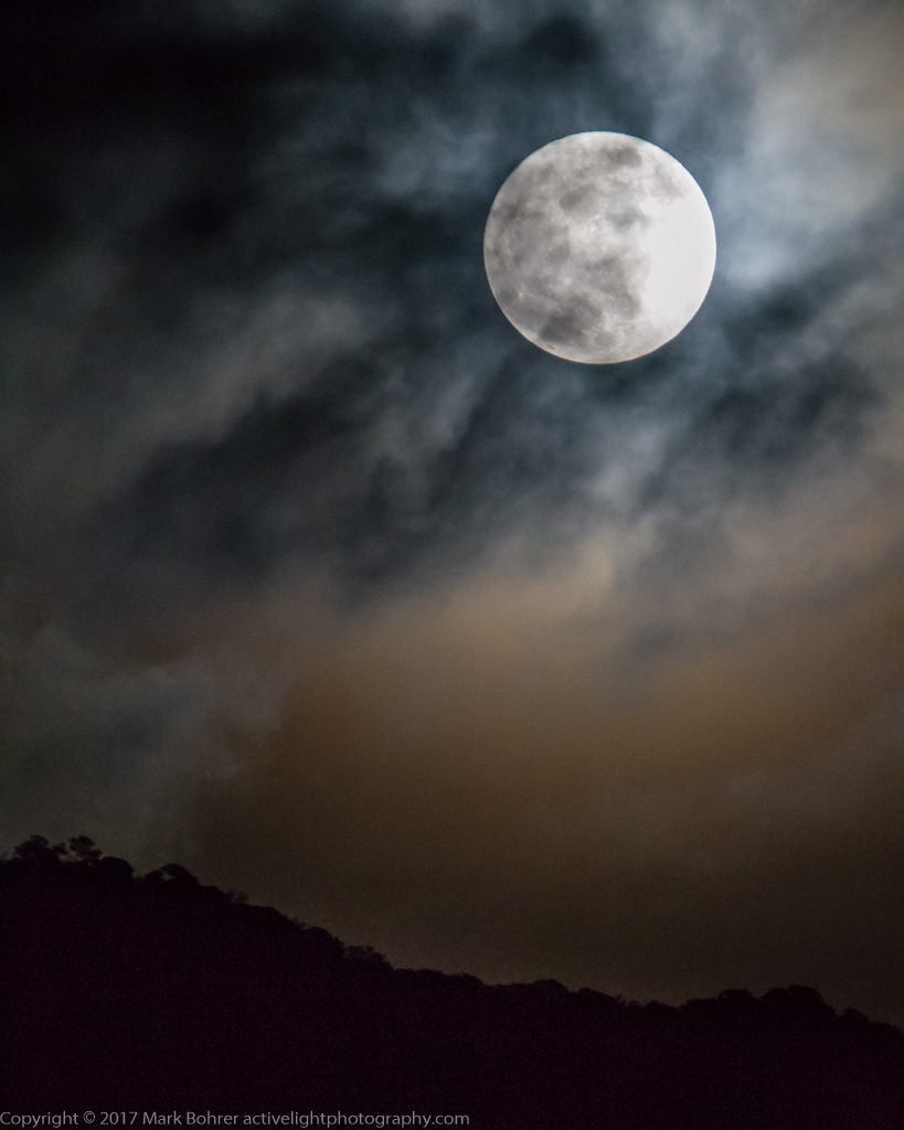 Moon behind the clouds, Albuquerque, New Mexico