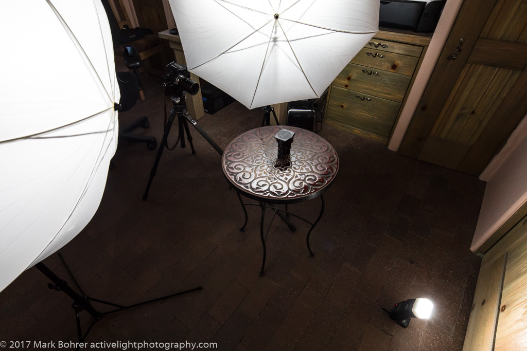 3-flash setup with umbrellas and a cap