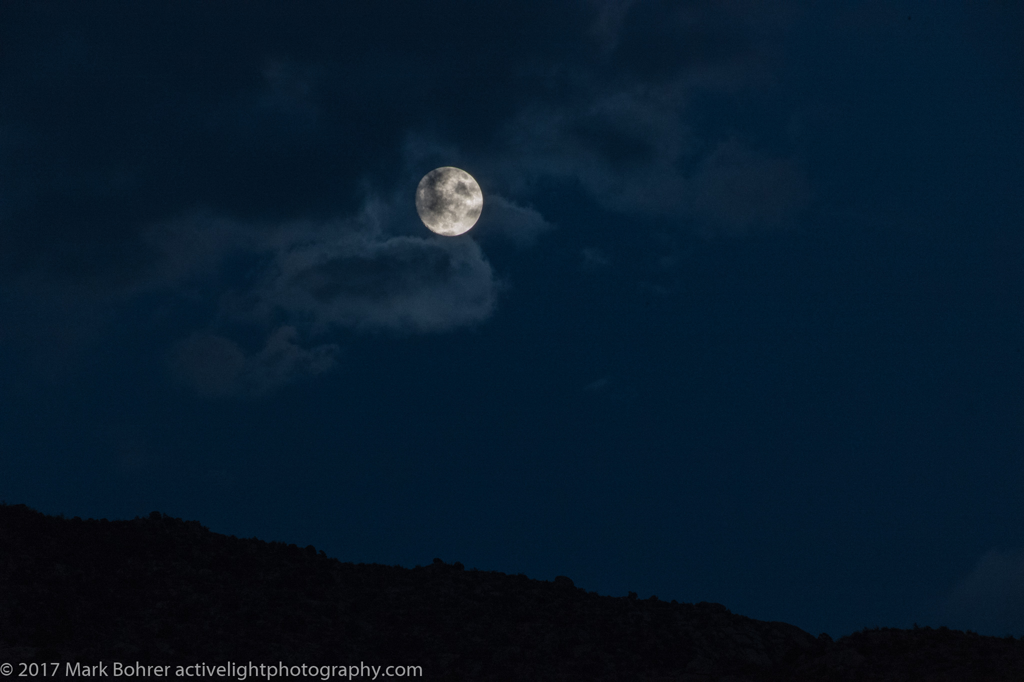 Moonrise with clouds