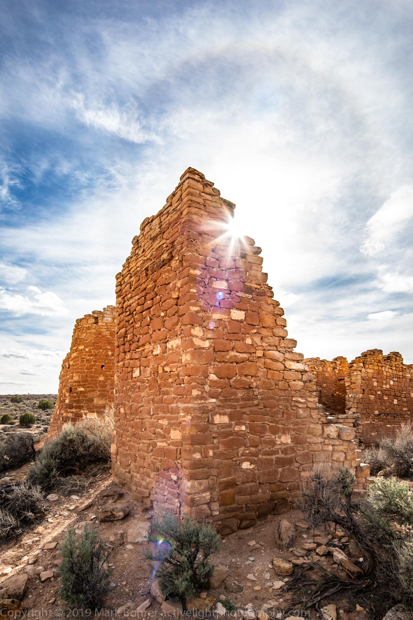Diffraction sunstar and cloud spectre, Hovenweep Castle